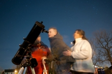 Tyler Scaglia, 9, (center) looks through a telescoope at jupiter Friday night at Washington Street Park during the Star Party. His mother, Bethany Sgaglia helps him to look into the scope and Mike Tartaglia, right, an amateur astronome watches on.  There were five large telescopes to view the sky from and dozens of folks showed up for the party. (Gabrielle Plucknette)