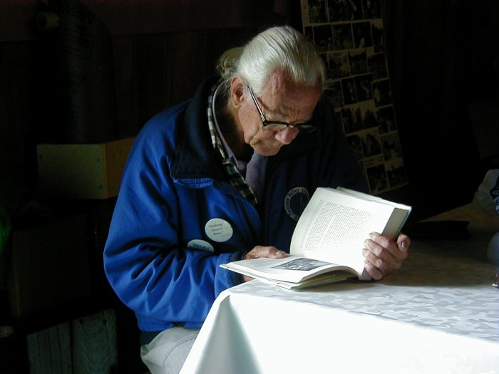 John Dobson reading during a quiet moment at the CT Star Party in 2001.